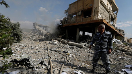 A Syrian firefighter is seen inside the destroyed Scientific Research Centre in Damascus, Syria, April 14, 2018 / Omar Sanadiki