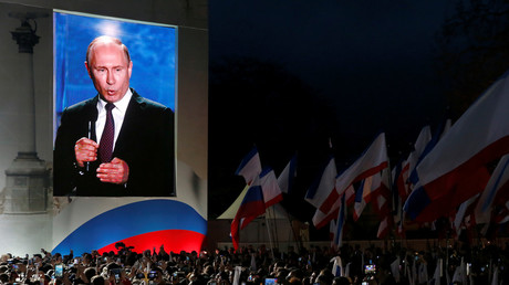 Russian president Vladimir Putin addresses the audience during a rally marking the anniversary of Crimea's reunification with Russia © Maxim Shemetov