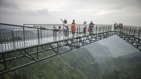 5bb62df3dda4c8e9308b456c Chilling VIDEO shows tourist's safety cord snapping during jump across 150m-high bridge in China