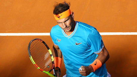 5ce18729fc7e9398328b463f Rafa's revege! Nadal serves Djokovic payback for Aus Open final demolition with Rome Masters win