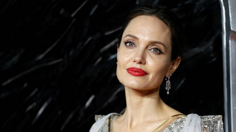 "FILE PHOTO: Angelina Jolie poses as she attends the UK premiere of ""Maleficent: Mistress of Evil"" in London, Britain October 9, 2019. Reuters / Peter Nicholls"