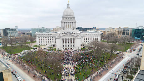 Residents protest Wisconsin's extended stay-at-home order at the Capitol building in Madison, Wisconsin, April 24, 2020.