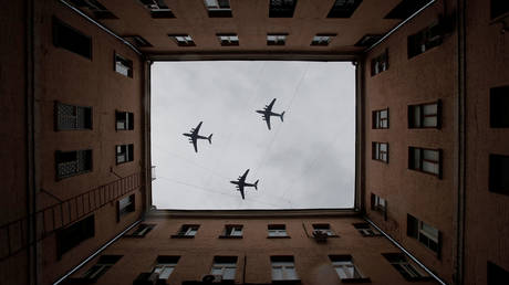 FILE PHOTO: Russian Il-76 military transport aircraft fly during a rehearsal for a flypast to mark the 75th anniversary of the victory over Nazi Germany in World War Two, in Moscow.