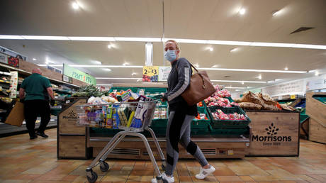 FILE PHOTO: A customer wearing a protective face mask shops at a Morrisons store in St Albans, UK, on September 10, 2020.