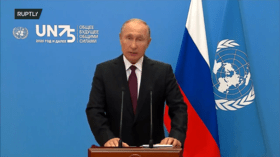 Putin says global economy won't recover from Covid-19 pandemic 'for a long time,' calls for world trade to be freed from sanctions
