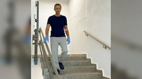 FILE PHOTO: Russian opposition politician Alexei Navalny goes downstairs at Charite hospital in Berlin, September 19, 2020