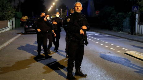 Police officers secure the area near the scene of the attack in the Paris suburb of Conflans St Honorine, France on October 16, 2020.