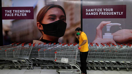 A man wearing a protective mask inside a mall after it reopened following the coronavirus disease outbreak, in Mumbai, India
