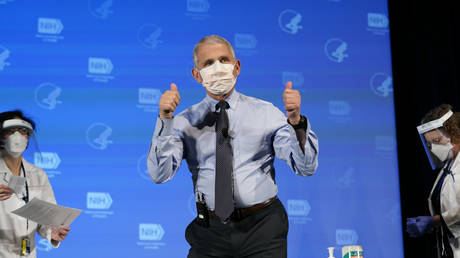 Dr. Anthony Fauci, director of the National Institute of Allergy and Infectious Diseases, gives the thumbs up after receiving his first dose of the COVID-19 vaccine at the National Institutes of Health on December 22, 2020 in Bethesda, Maryland.