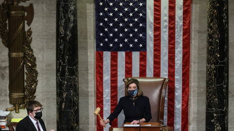 U.S. House Speaker Nancy Pelosi (D-CA) presides over the vote to impeach President Donald Trump for a second time on the floor of the House of Representatives in Washington January 13, 2021. © REUTERS/Jonathan Ernst