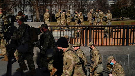 FILE PHOTO: National Guard troops gather outside the US Supreme Court building in the lead-up to President-elect Joe Biden's inauguration, in Washington, DC.