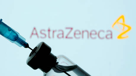 FILE PHOTO: A vial and sryinge are seen in front of a displayed AstraZeneca logo in this illustration taken January 11, 2021.