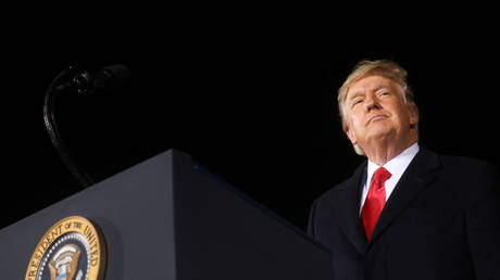 FILE PHOTO: Then-president Donald Trump addresses a campaign rally in Dalton, Georgia, January 4, 2021.