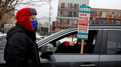 Chicago teachers are shown participating in a caravan late last month to make their case for school-reopening terms.