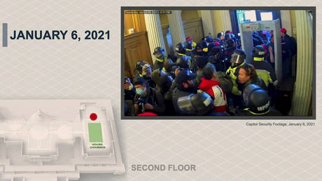 An except from footage of the January 6 riot at the US Capitol, presented at former president Donald Trump's impeachment trial in Washington, DC, February 10, 2021.