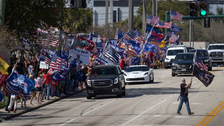 Supporters greet former US President Donald in West Palm Beach, Florida, February 15, 2021
