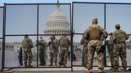 National Guard soldiers keep watch outside the US Capitol, in Washington, DC, January 14, 2021.