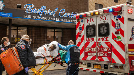 A nursing home resident is placed in an ambulance in the Brooklyn borough of New York, US, April 16, 2020.