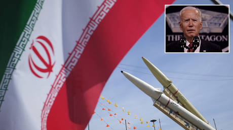 FILE PHOTO: Iran-made, Dezful medium range ballistic missile and Zolfaghar road-mobile single-stage solid-propelled liquid fueled missile are seen next to an Iran flag in the Azadi square. © Getty Images / Morteza Nikoubazl / NurPhoto; (inset) US President Joe Biden © REUTERS / Carlos Barria