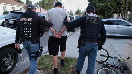 ICE Field Office Director, Enforcement and Removal Operations, David Marin and U.S. Immigration and Customs Enforcement's (ICE) Fugitive Operations team arrest a Mexican national at a home in Paramount, California, US, March 1, 2020.