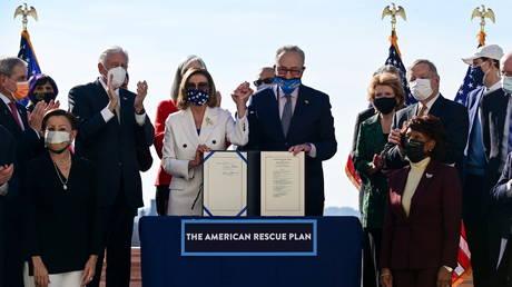 House and Senate Democrats celebrate the passage of the American Rescue Plan coronavirus bill, March 10, 2021.