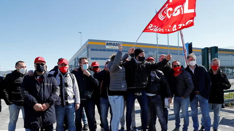 Workers at Amazon's logistics operations in Italy protest outside a distribution centre in Passo Corese, Italy March 22, 2021.