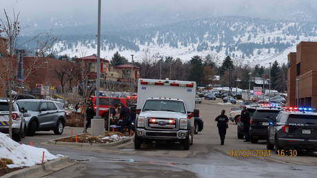Police officers and an ambulance are seen at the scene where an active shooter was reported at a grocery store in Boulder, Colorado, March 22, 2021.