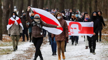 US-backed opposition activists wave banners of the 1918-19 'Belarus People's Republic' during a protest in Minsk, December 13, 2020.