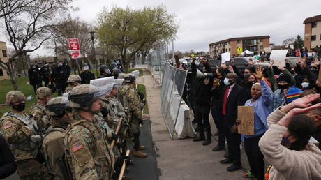 Protesters rally outside Brooklyn Center Police Department as it is guarded by members of the police and National Guard, a day after Daunte Wright was shot and killed by a police officer, in Brooklyn Center, Minnesota, US, April 12, 2021