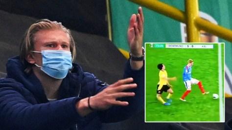 Look away now: Sickened Erling Haaland can't watch as teammate