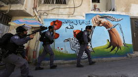 Israeli police clash with Palestinians trying to prevent demolition of Arab-owned shop in East Jerusalem