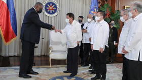 Duterte won't scrap military pact with US despite prior threats, Philippines defense minister says during Pentagon chief's visit