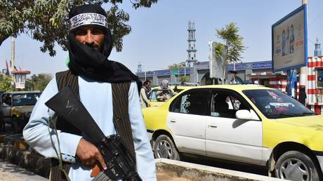 A militant of Taliban (banned in Russia) holds a rifle while standing on a street in Mazar-i-Sharif, Afghanistan. The Taliban offensive across Afghanistan was completed on August 15 by the seizure of Kabul. Ashraf Ghani left the country. The movement declared the end of the years-long war.