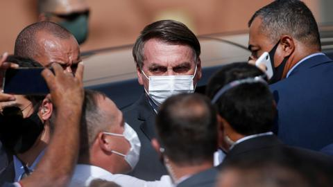 Bolsonaro refuses calls to stop to slow down Covid-19 as the death toll rises