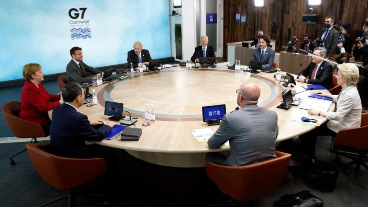 G-7 leaders, and European Commission President Ursula von der Leyen, European Council President Charles Michel sit around a table during the G-7 summit at the Carbis Bay Hotel in Carbis Bay, St. Ives, Cornwall, England, Friday, June 11, 2021.