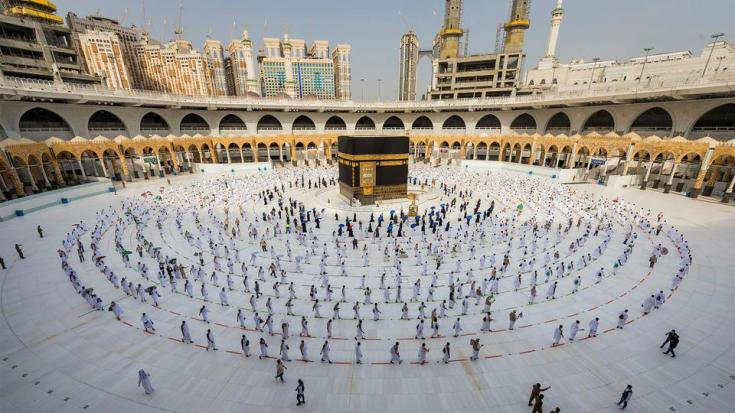 In this July 31, 2020, file photo, pilgrims walk around the Kaaba at the Grand Mosque in the Muslim holy city of Mecca, Saudi Arabia.