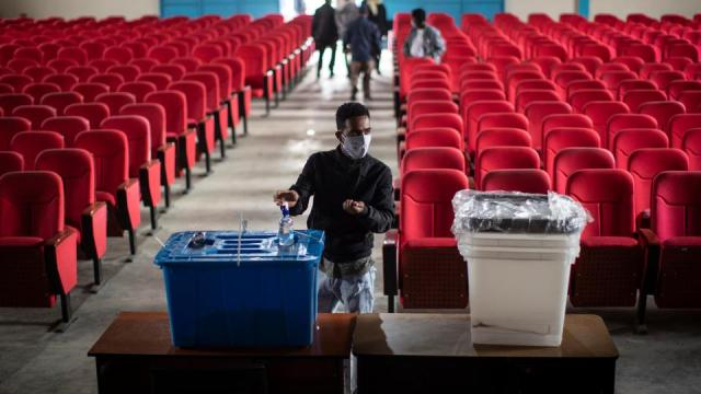 An electoral worker sanitises his hands after delivering ballot boxes to a polling station in the capital Addis Ababa, Ethiopia, June 20, 2021.