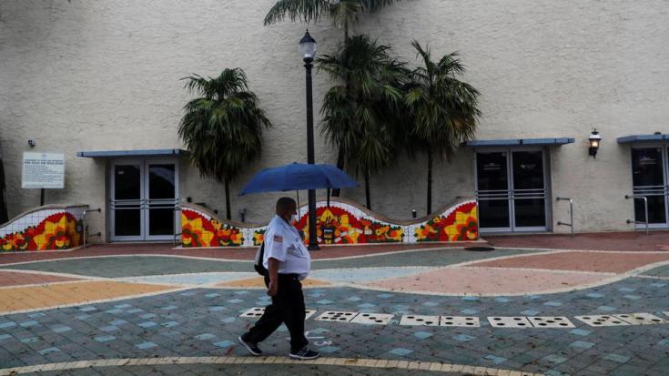 A man walks with an umbrella ahead of Tropical Storm Elsa in the Little Havana neighbourhood of Miami, Florida, US, on July 5, 2021.