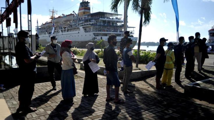 Mass vaccination programme at Benoa Harbor, Denpasar, Bali, Indonesia July 6, 2021.