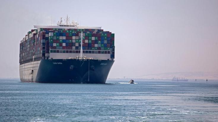 This picture on July 7, 2021 shows a view of the Panama-flagged MV 'Ever Given' container ship sailing along Egypt's Suez Canal near the canal's central city of Ismailia.