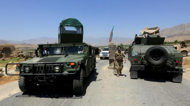 Afghan soldiers patrol the area near a checkpoint recaptured from the Taliban, in the Alishing district of Laghman province on July 8, 2021.