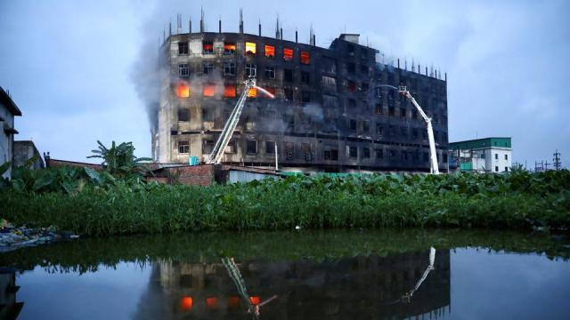 Flames rise the morning after a fire broke out at a factory named Hashem Foods Ltd. in Rupganj of Narayanganj district, on the outskirts of Dhaka, Bangladesh, July 9, 2021.