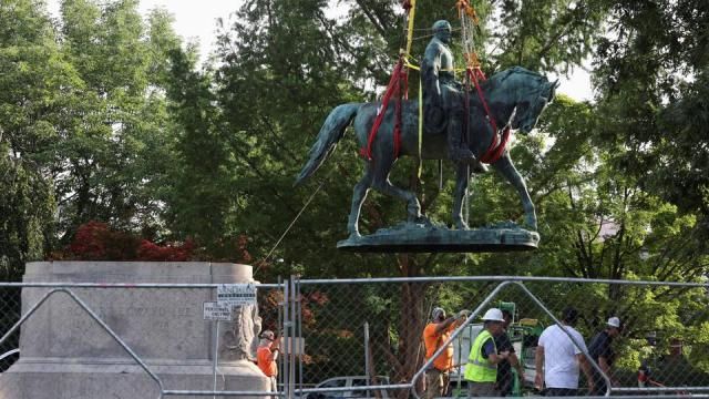 Workers remove a statue of Confederate General Robert E. Lee, after years of a legal battle over the contentious monument, in Charlottesville, Virginia, on July 10, 2021.
