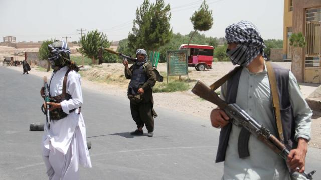 Local militia members hold weapons to support Afghan forces in their fight against Taliban, on the outskirts of Herat province, Afghanistan on July 10, 2021.