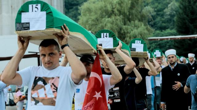Coffins of 19 victims of Srebrenica genocide are being carried from the old factory building to be buried at Potocari Memorial Cemetery, on the 26th anniversary of the genocide in Srebrenica on July 10, 2021.
