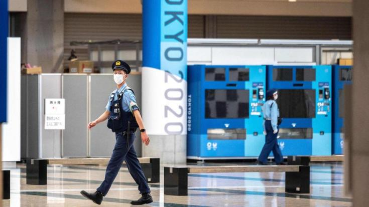 A policeman patrols the Olympic Games media centre during a state of emergency in Tokyo, Japan on July 12, 2021.