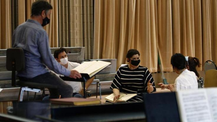Opera singers rehearse a scene from Le nozze di Figaro (The Marriage of Figaro) at the Santa Fe Opera for its first show of the pandemic