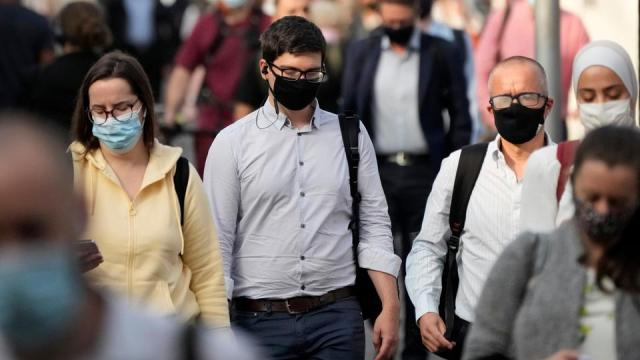 People wear face masks to curb the spread of coronavirus during the morning rush hour at Waterloo train station in London, on July 14, 2021.