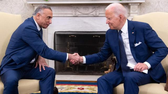 US President Joe Biden shakes hands with Iraqi Prime Minister Mustafa al Kadhimi (L) in the Oval Office of the White House in Washington, DC on July 26, 2021.