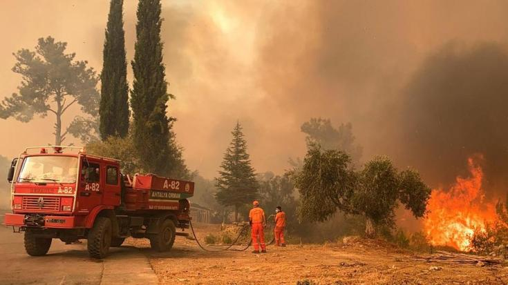 A firefighter tries to battle a massive wildfire that has engulfed a Mediterranean resort region along Turkey's southern coast near the town of Manavgat, on July 29, 2021.
